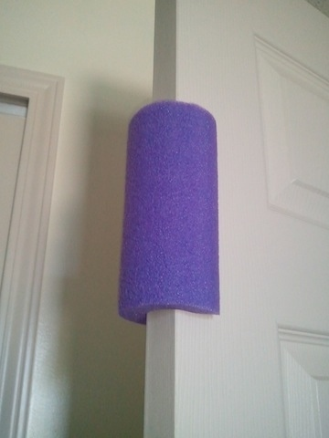 Repurpose a pool noodle to become a toddler-proof door stopper.