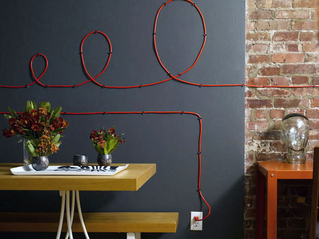 Turn unsightly cords into wall art